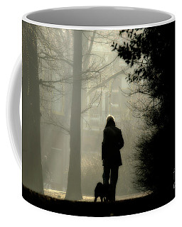Coffee Mug featuring the photograph Woman Walking Dog by Patricia Hofmeester