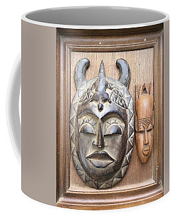 Coffee Mug featuring the relief Wooden Masks In Frame by Douglas Fromm