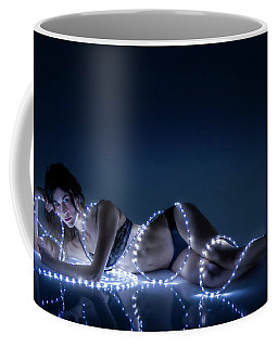 Coffee Mug featuring the photograph Wrapped In Light by Rikk Flohr