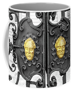 Coffee Mug featuring the photograph Wrought Iron Gate With Baroque Grinning Gold Cherubs by Menega Sabidussi