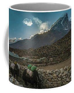 Coffee Mug featuring the photograph Yaks Moving Through Dingboche by Mike Reid