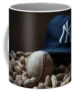 Coffee Mug featuring the photograph Yankee Cap Baseball And Peanuts by Terry DeLuco