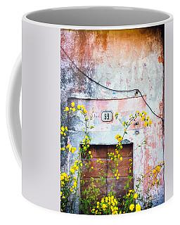 Yellow Flowers And Decayed Wall Coffee Mug