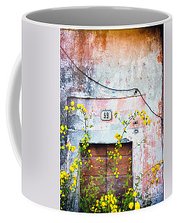 Yellow Flowers And Decayed Wall Coffee Mug