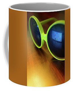 Coffee Mug featuring the photograph Yellow Goggles With Reflection by Carlos Caetano