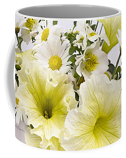 Coffee Mug featuring the photograph Yellow Petunias And Daisies  by Sandra Foster