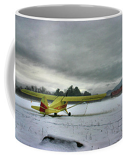 Yellow Plane In Winter Coffee Mug
