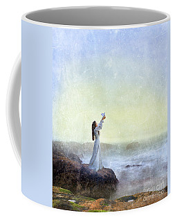 Young Lady Releasing A Dove By The Sea Coffee Mug by Jill Battaglia