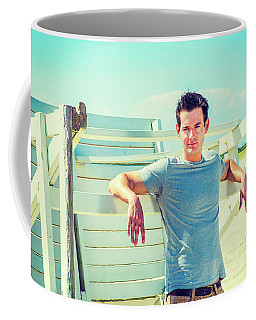 Young Man Relaxing On The Beach Coffee Mug
