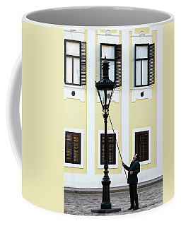 Coffee Mug featuring the photograph Zagreb Lamplighter by Steven Richman