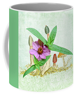 Zinnia In The Mushrooms Coffee Mug by Larry Bishop