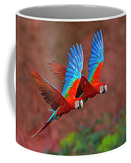 Close Up Of Two Flying Red-and-green Coffee Mug