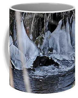 Coffee Mug featuring the photograph It Never Freezes by Ann E Robson