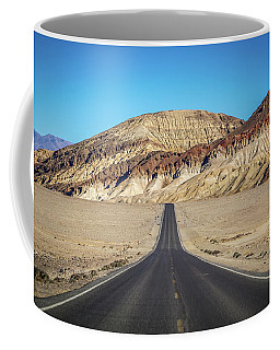 Coffee Mug featuring the photograph Lonely Road In Death Valley National Park In California by Alex Grichenko