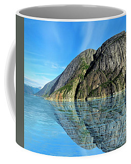 Coffee Mug featuring the photograph Alaska Rock Reflection by Joan Stratton