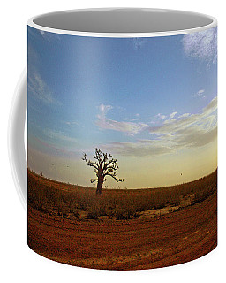 Coffee Mug featuring the photograph Baobab Tree At Sunset by Mark Duehmig