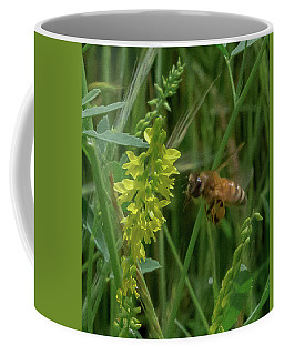 Coffee Mug featuring the photograph Bee In Flight by Lora J Wilson