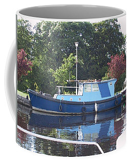 Coffee Mug featuring the painting Blue Boat At Cloondara Harbour. by Val Byrne