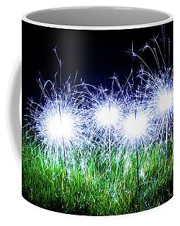 Coffee Mug featuring the photograph Blue Sparklers In The Grass by Scott Lyons
