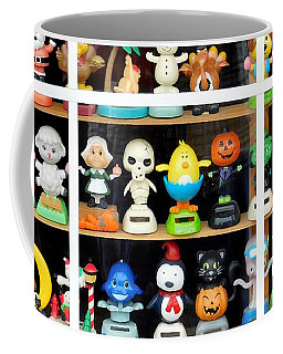 Coffee Mug featuring the photograph Bobbleheads In Store Window In Schroon Lake Ny In Adirondacks by Rose Santuci-Sofranko