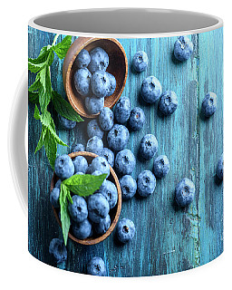 Bowl Of Fresh Blueberries On Blue Rustic Wooden Table From Above Coffee Mug