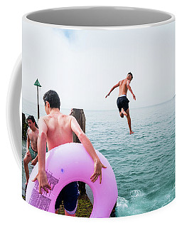 Boys Jumping Into The Sea Coffee Mug