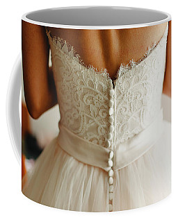 Bride Getting Ready, They Help Her By Buttoning The Buttons On The Back Of Her Dress. Coffee Mug