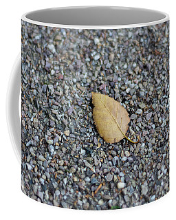 Coffee Mug featuring the photograph Brown Leaf On Gravel by Scott Lyons
