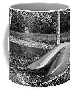 Coffee Mug featuring the photograph Canoes And A Boathouse Bnw by Rachel Hannah