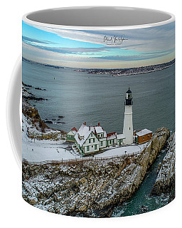 Coffee Mug featuring the photograph Cold Day, Warm Light At Portland Head Light by Michael Hughes