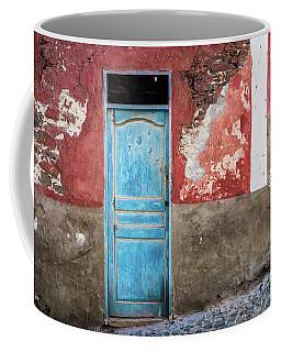 Colorful Wall With Blue Door Coffee Mug