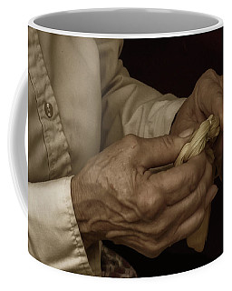 Coffee Mug featuring the photograph Corn Husk Doll Maker by Guy Whiteley