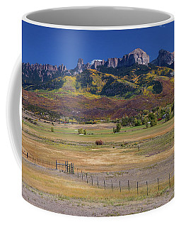 Coffee Mug featuring the photograph Courthouse Mountains And Chimney Rock Peak by James BO Insogna