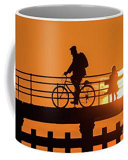 Cyclist Silhouetted At Sunset Coffee Mug