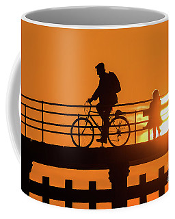 Cyclist Silhouetted At Sunset Coffee Mug