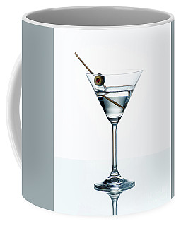 Dry Martini With Green Olive In Cocktail Glass Over White Backgr Coffee Mug