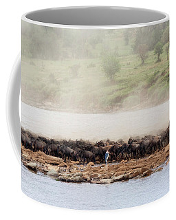 Coffee Mug featuring the photograph Dust Of The Wildebeest by Kay Brewer