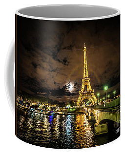 Coffee Mug featuring the photograph Eiffell Tower At Night After The Storm Passed by PorqueNo Studios