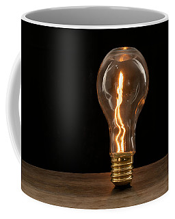 Fire Sparks Inside A Light Bulb Coffee Mug