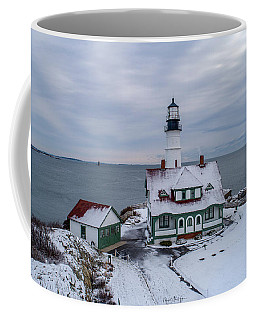 Coffee Mug featuring the photograph First Snow At Portland Head Lighthouse by Michael Hughes