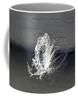 Coffee Mug featuring the photograph Floating Feather by Ann E Robson