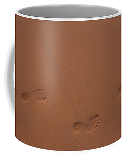 Coffee Mug featuring the photograph Foot Prints In Sand by Stuart Manning