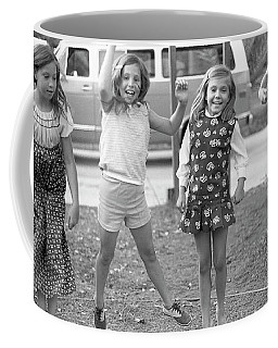 Four Girls, Jumping, 1972 Coffee Mug