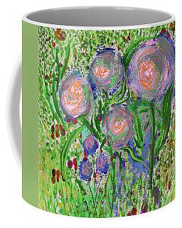 Four Pink Flowers In Green Coffee Mug