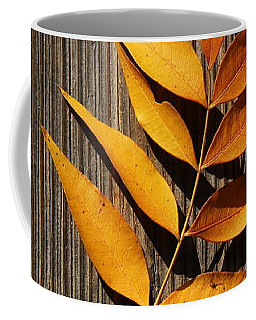 Coffee Mug featuring the photograph Golden Autumn Leaves On Wood by Debi Dalio