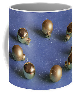 Golden Christmas Balls On The Snowy Background Coffee Mug