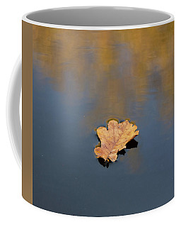Coffee Mug featuring the photograph Golden Leaf On Water by Scott Lyons