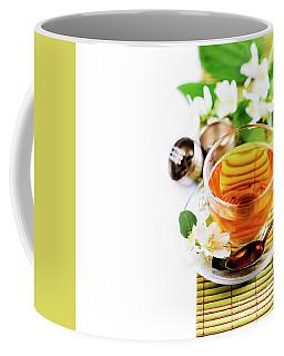 Herbal Green Tea With Jasmine Flower In Transparent Teacup Borde Coffee Mug