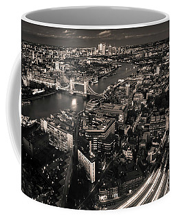 Coffee Mug featuring the photograph London At Night by Chris Cousins