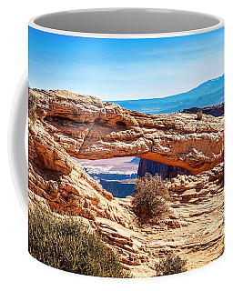 Coffee Mug featuring the photograph Mesa Arch by Andy Crawford